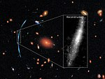 Hubble pushed beyond limits to spot clumps of new stars in distant galaxy.jpg