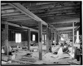 INTERIOR VIEW OF FLOUR MILL, SECOND STORY, LOOKING NORTH - Rocky Boy's Agency Flour Mill, Rocky Boy, Hill County, MT HAER MONT,21-ROBA,1-8.tif