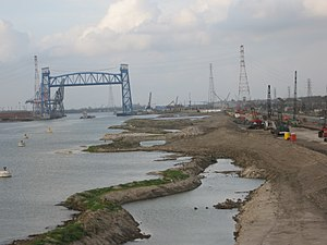Industrial Canal - Post-Katrina temporary earthen levee under construction where a floodwall failed, with Florida Avenue Bridge in distance