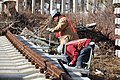 Installing concrete tie panels on Rockaway Line (11294150854).jpg