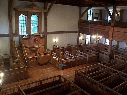 Interior of the Old Ship Church, a Puritan meetinghouse in Hingham, Massachusetts. Puritans were Calvinists, so their churches were unadorned and plain. It is the oldest building in continuous ecclesiastical use in America and today serves a Unitarian Universalist congregation. InteriorOldShip.jpg