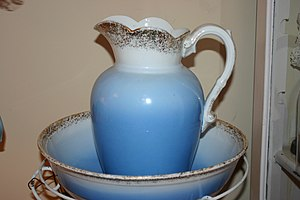 Ironstone china - An ironstone pitcher and washbowl. Ironstone's resistance to chipping made it a popular material for pitchers and other everyday tableware in the 19th century.