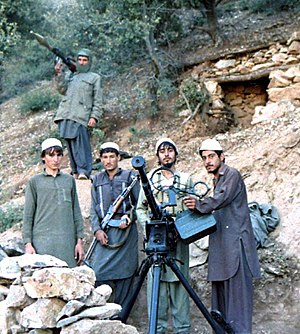 Jamiat-e Islami - Hezb-e Islami Khalis fighters in the Sultan Valley of Kunar Province, showing a captured DShK in 1987.