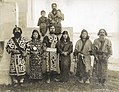 Japanese Ainu group of four men and two women (standing) with seated young boy and man holding a baby in the Department of Anthropology exhibit at the 1904 World's Fair.jpg