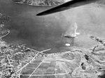 Japanese ship under attack by U.S. Navy carrier aircraft at Kure, Japan, 24 July 1945 (NNAM.2013.044.022).jpg