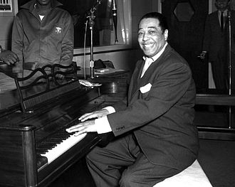 Duke Ellington - Ellington poses with his piano at the KFG Radio Studio November 3, 1954.