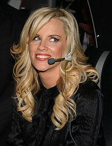 McCarthy smiling and wearing a headset microphone