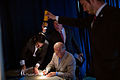 Joe Biden signs autographs by torchlight.jpg