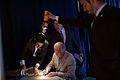 Joe Biden signs autographs by torchlight.jpg