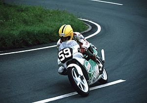 Joey Dunlop - Dunlop riding a 125 exiting the Gooseneck, a bend at the start of the mountain section of the Isle of Man TT course