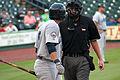 Jose Morales and umpire Sugar Land July 2014.jpg