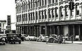 June, 1943 -- Bus Depot and part of the old Savings Bank Building, West Huron Street, Ann Arbor, Michigan.. (14288716248).jpg