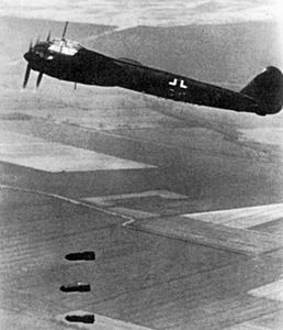 Junkers Ju 88A dropping bombs over Britain 1940.jpg