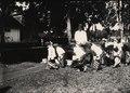 KITLV - 183057 - Demmeni, J. - Teacher and students in Java - circa 1910.tif