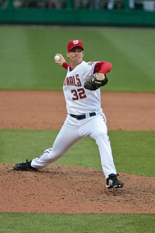 Kip wells in his wind-up, preparing to throw a pitch for the Washington Nationals, wearing uniform number 32.