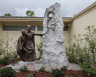 Marcellin Champagnat - Life-size bronze statue of St Marcellin Champagnat outside Parramatta Marist High School by sculptor Linda Klarfeld