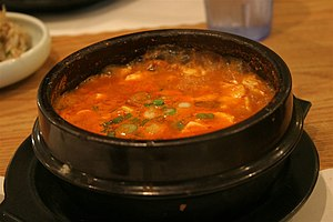 Sundubu jjigae(순두부찌개), a Korean stew made with...