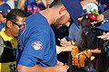Kris Bryant signing autographs during his rehab assignment against Omaha (43598165194).jpg