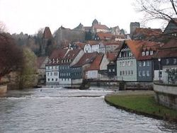 Historical town center of Kronach with the river Hasslach in the foreground.