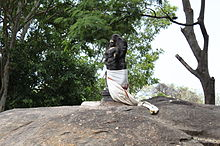 The Murugan Statue in Kumbakarai Falls