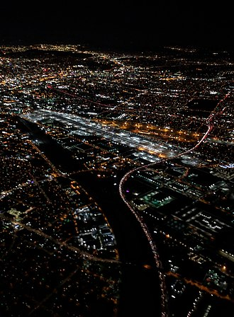 Interstate 710 - Night aerial view of the Los Angeles River where I-710 converges on it (from the right) at the City of Commerce
