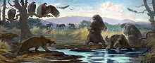 Painting of sloth in tar pit menaced by saber-toothed cat, with condors waiting in a tree