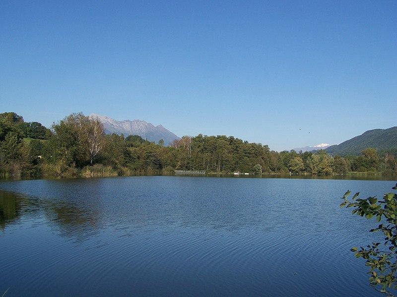 Sight of lac de Sainte-Hélène in Savoie, France. At the background can be seen Mont Arclusaz mount and the Mont-Blanc.