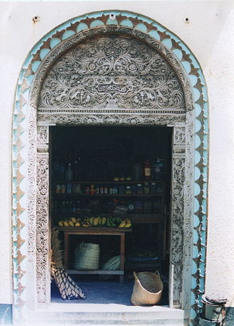 Kenya - A traditional Swahili carved wooden door in Lamu.