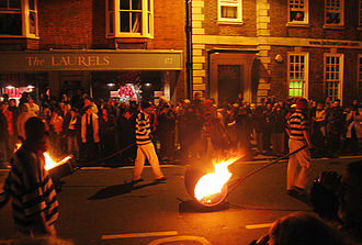 Lewes Bonfire - Members of the Lewes Borough Bonfire Society drag burning tar barrels through the streets of Lewes as part of their Bonfire Night celebrations.