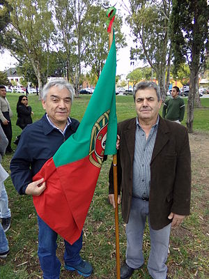 Portuguese Argentine - Two Portuguese Argentines holding a Portuguese flag in Trelew, Chubut Province.