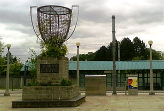 """Fair Complex/Hillsboro Airport MAX Station - """"World's Greatest"""" in the foreground and the station shelter behind"""
