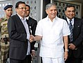 Maithripala Sirisena being received by the Minister of State for Planning (Independent Charge) and Defence, Shri Rao Inderjit Singh on his arrival, at Indira Gandhi International Airport, in New Delhi.jpg