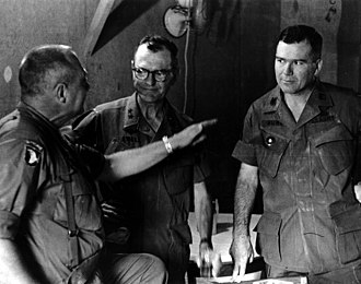 Julian Ewell - Major General Julian J. Ewell (center) listens to 1st Brigade commander Colonel John Geraci while Colonel Ira A. Hunt Jr., the 9th Infantry Division chief of staff, stands to the right.