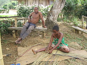 Malagasy people - A Malagasy girl weaving a mat from local materials