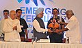 Manmohan Singh being presented a memento by the Chief Minister of Kerala, Shri Oommen Chandy, at the inauguration of the 'Emerging Kerala-2012–Global Connect', at Kochi. The Governor of Kerala.jpg