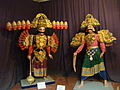 Mannequins of Ravana and his son on display in Janapada Loka (Folk art museum).jpg