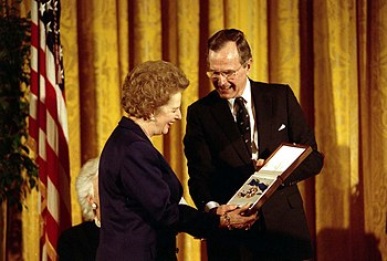 U.S. President George H. W. Bush awards former...