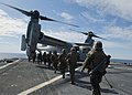 Marines prepare to board an Osprey helicopter. (6807752065).jpg