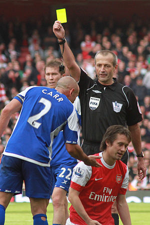 Martin Atkinson - Atkinson issues a yellow card during a fixture between Birmingham City and Arsenal in 2010