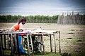 Masai women preparing her market stand.jpg