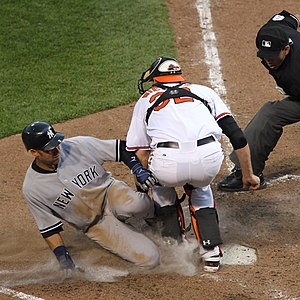 Catcher - Catcher Matt Wieters blocks runner Derek Jeter from tagging home plate.