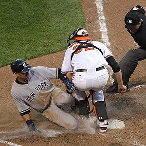 Matt Wieters blocks home plate from Derek Jeter.