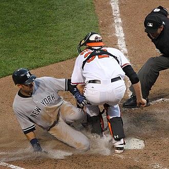 Catcher - Catcher Matt Wieters blocks runner Derek Jeter from tagging home plate.
