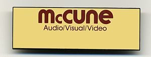 McCune Audio/Video/Lighting - A blank name badge from the 1980s. This style badge was worn by McCune Staff at the in house hotel accounts where McCune provided audio visual services.
