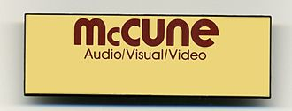 McCune Audio/Video/Lighting - A blank McCune name badge from the 1980s. This placard style staff badge was worn by the McCune audio visual technicians and staff at the many in house hotel and convention center accounts where McCune provided contacted audio visual services.