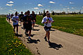 Members of Detachment 226 from the U.S. Air Force Office of Special Investigations and South Dakota law enforcement run with athletes from the South Dakota Special Olympics during the Law Enforcement Torch Run 100517-F-UJ876-104.jpg