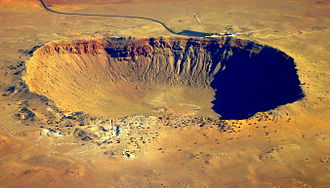 B612 Foundation - The 1,200 meter-wide Meteor Crater in Arizona, United States, created by a 46 meter-diameter asteroid impact. A visitors centre is visible beyond the far rim.