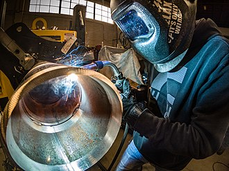 Welding - Gas Metal Arc Welding (MIG welding) on pipe.