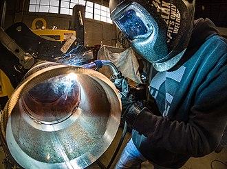 Welding - Gas Metal Arc Welding (MIG welding) on pipe.