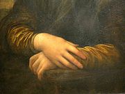 Detail of Lisa's hands, her right hand resting on her left hand. Leonardo chose this gesture rather than a wedding ring to depict Lisa as a virtuous woman and faithful wife.